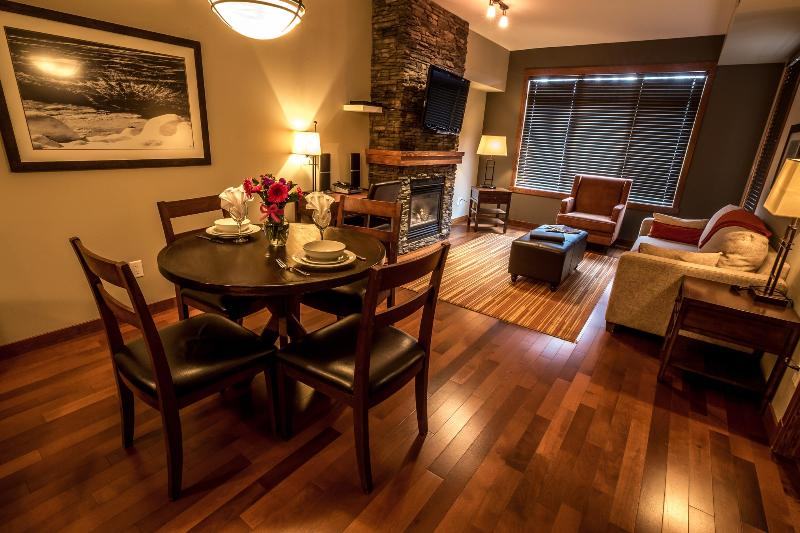 This chic condo boasts stunning hardwood floors and a beautiful rock fireplace. - Canmore Stoneridge Mountain Resort Beautiful 1 Bed Condo (King) - Canmore - rentals