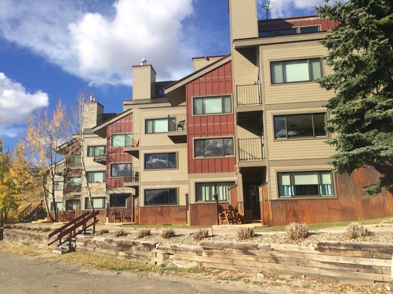 Exterior fall view - our unit has both a patio and a deck - Buttes Condo - Ski in/out. Mountain Luxury. - Crested Butte - rentals