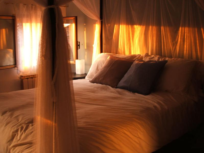 The romantic bedroom aglow at sunset - Live the dream in your own Venetian apartment - Venice - rentals