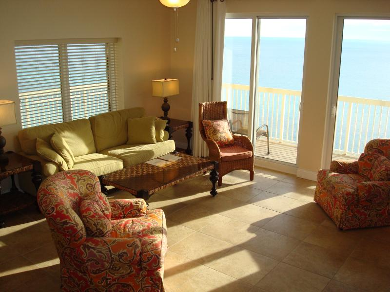 Spacious living room with new tile and wrap around views of the Gulf - CORNER UNIT BLISS @CALYPSO! FREE BchChrs & WIFI - Panama City Beach - rentals