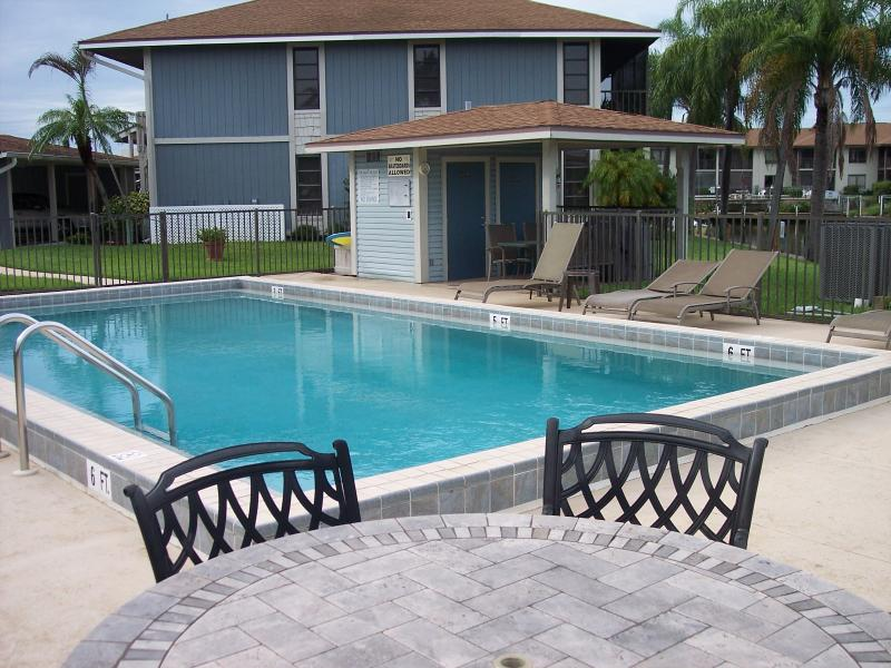Heated Swimming Pool, lounge chairs, overlooking intersecting canal views. - Waterfront 2/2,Heated Pool,Dock,First Floor - Cape Coral - rentals
