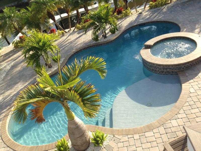 Primo Pool and Palms - Times Square Gem!  4BR Canal Front Home Sleeps 12 - Fort Myers Beach - rentals