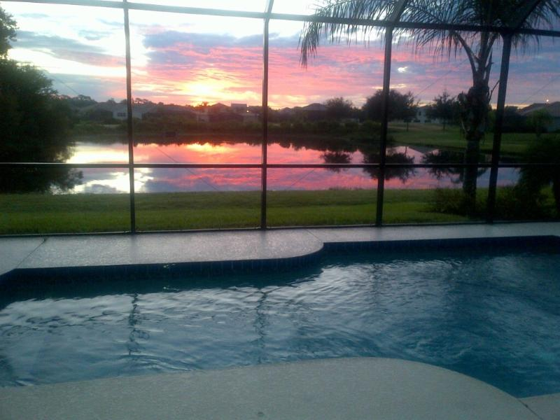 Wake up to this spectacular sunrise. Put on the coffee - Executive Retreat.  Beautiful Well Appointed Home in desirable Heritage Harbour - Bradenton - rentals