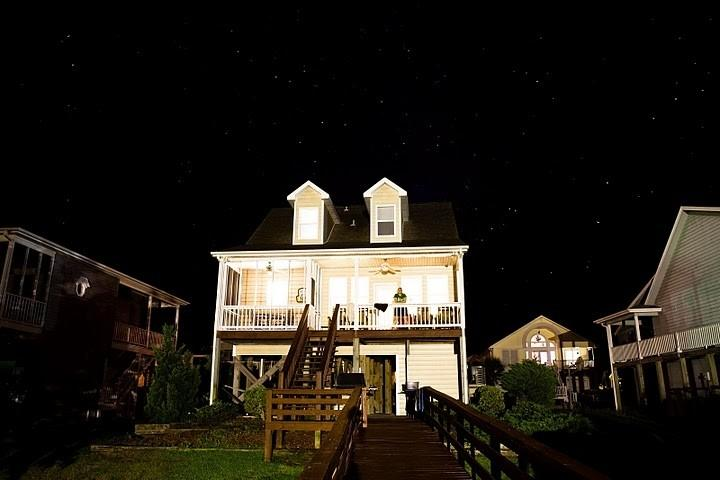 """Miller Time"" in the evening looking up from the dock and waterway. - Holden Beach Waterway Island Home; Sleeps 10 - Holden Beach - rentals"