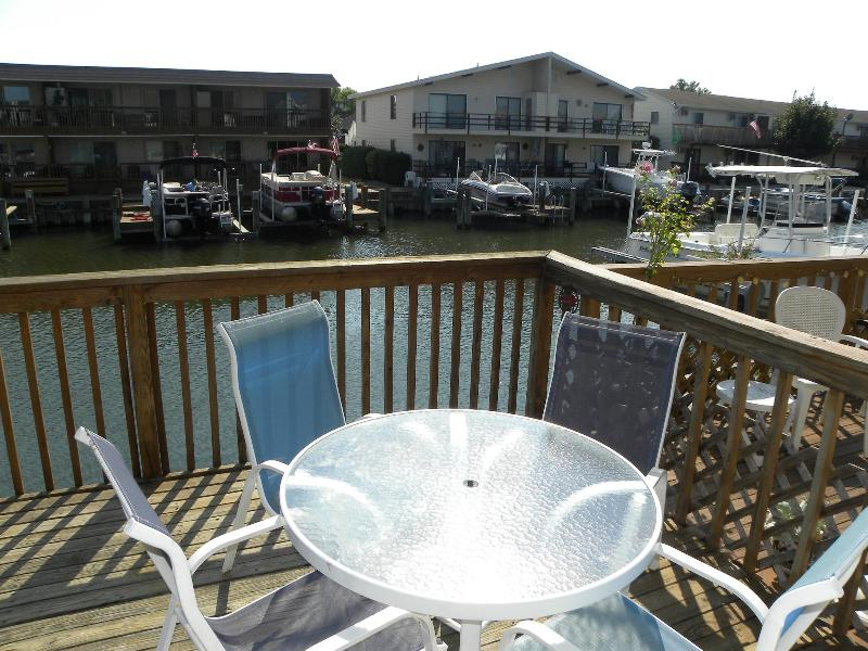 Deck with plenty of seating overlooking wide canal leading out to open bay - Bayside Canal 2 blocks to the Beach - Ocean City - rentals