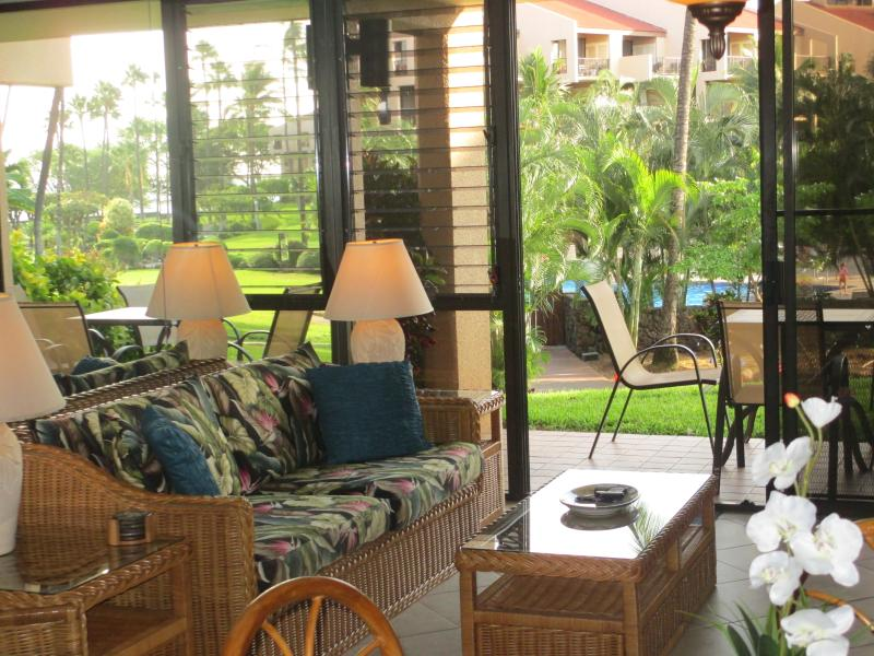 Looking out the lanai towards the pool. - South Kihei, Kamaole Sands, Ground floor condo - Kihei - rentals