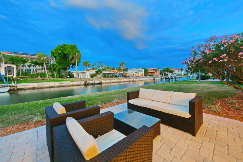 Backyard Seating Area with Waterway Views - Waterfront 4 BR Home with Private Dock and Screened Pool. Walk to Beach! - Longboat Key - rentals