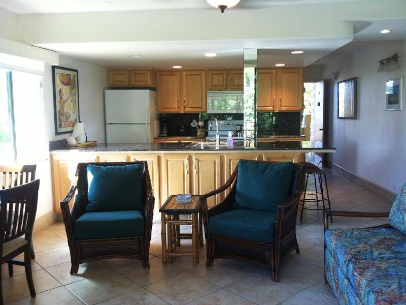 Family room & kitchen (nice open layout) - master bedroom is behind couch on right - 2 Bed/2 Bath/2 Min. Walk to Ocean-Family Friendly! - Lahaina - rentals