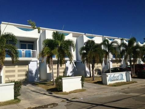 Our 8-unit building on a residential street. We are on the end and have the most windows and space. - Affordable Luxury Townhouse, Beachside, Rincon, PR - Rincon - rentals