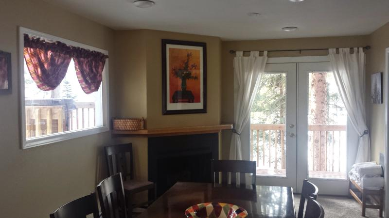 Dining room and view of the deck and hot tub - 2 Blocks From Main Street, Quiet Setting - Frisco - rentals