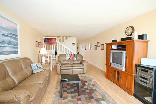 living room showing stairs - Heavenly House in San Diego (3750 Bayside Walk #08) - San Diego - rentals