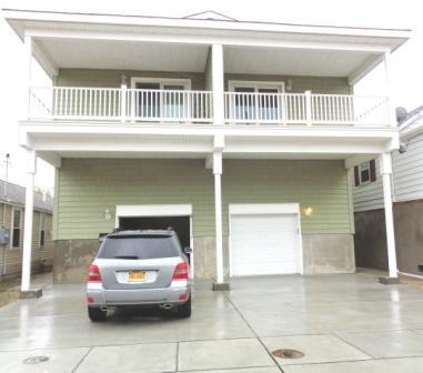GARAGE ENTRANCE, 2 CARS ONE IN THE GARAGE ONE ON DRIVEWAY - FOUR BEDROOM THREE FULL BATHS BRAND NEW CONDO - Seaside Heights - rentals