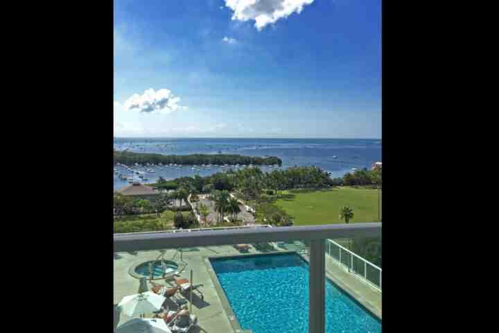 View of the pool and bay from the actual apartment balcony - **Fall Promo* Bay View Studio at Sonesta in Coconut Grove, Near South Beach, Brickell & Key Biscayne - Coconut Grove - rentals