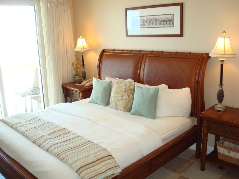 Master bedroom with king size bed, en suite bath & large walk-in closet - PERFECT GULF COAST ESCAPE @ CALYPSO,  3rd Flr - Panama City Beach - rentals
