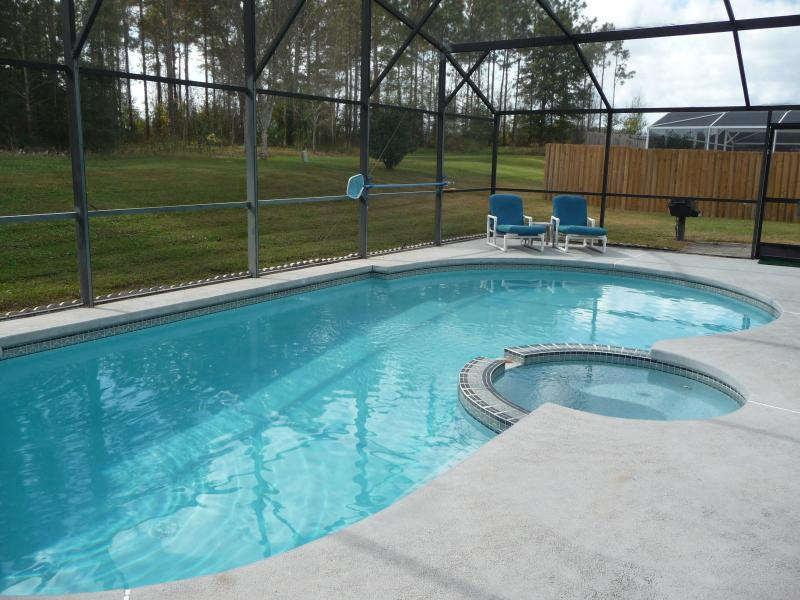 Pool and jacuzzi view - A hideaway dream - an amazing spacious family home - Kissimmee - rentals