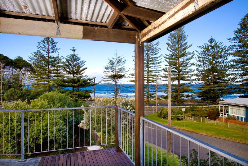 Step onto the Sand At Sharkies Beach - Image 1 - Coledale - rentals
