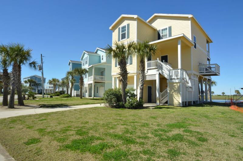 South-facing front view of our cottage - Right by the beach crossover! Pointe West 3BR/3BA 2nd Row Luxury Beach Cottage - Galveston - rentals