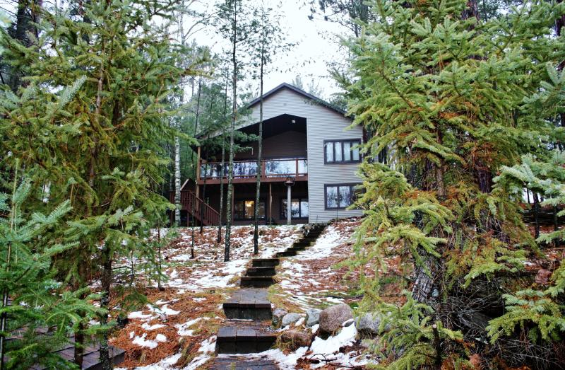 Backside of house overlooking the lake - beautiful views from the house. - QUICK ESCAPE on Echo Lake - Eagle River/St Germain - Eagle River - rentals
