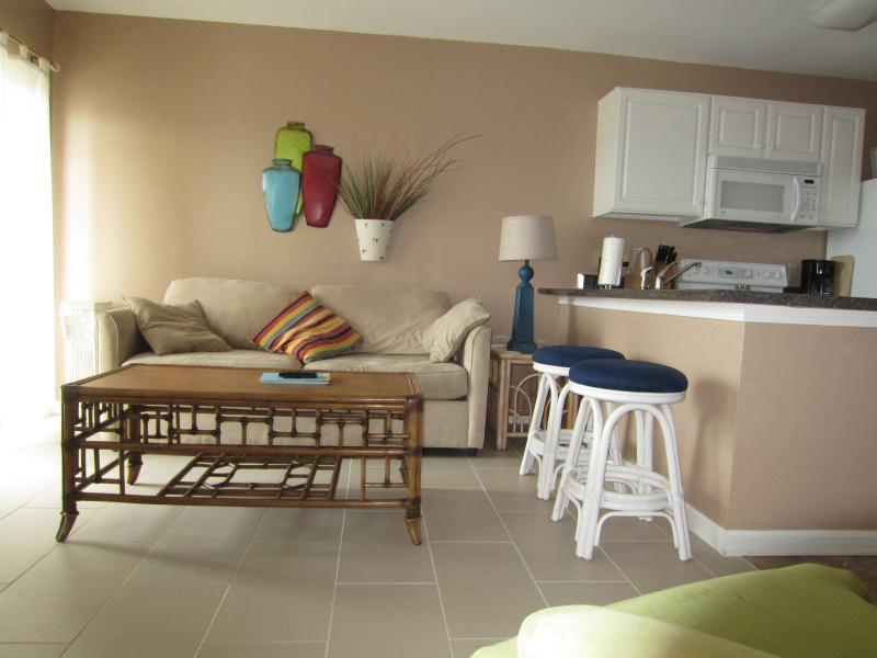 Relax on the comfy sofa after a day on the beach - Grand Caribbean 3rd floor corner unit - Orange Beach - rentals