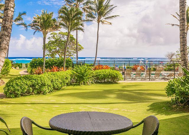 Lanai with beautiful ocean and pool views - Kapaa Shore Resort  #118, Ocean View, King Bed, Complimentary Wifi & Parking - Kapaa - rentals