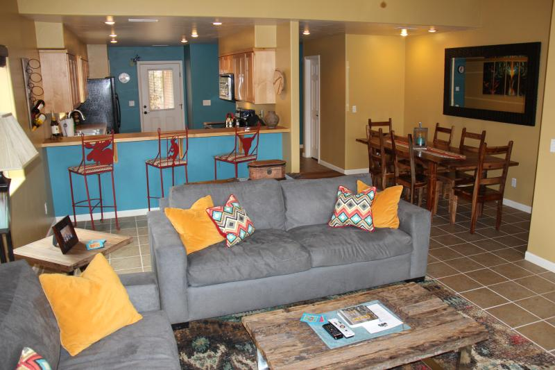 Large open living area with tons of seating, open to dining and kitchen areas. - LIVE 2 RIDE - POOL/HOT TUB/AIR HOCKEY/FOOSBALL!! - Moab - rentals