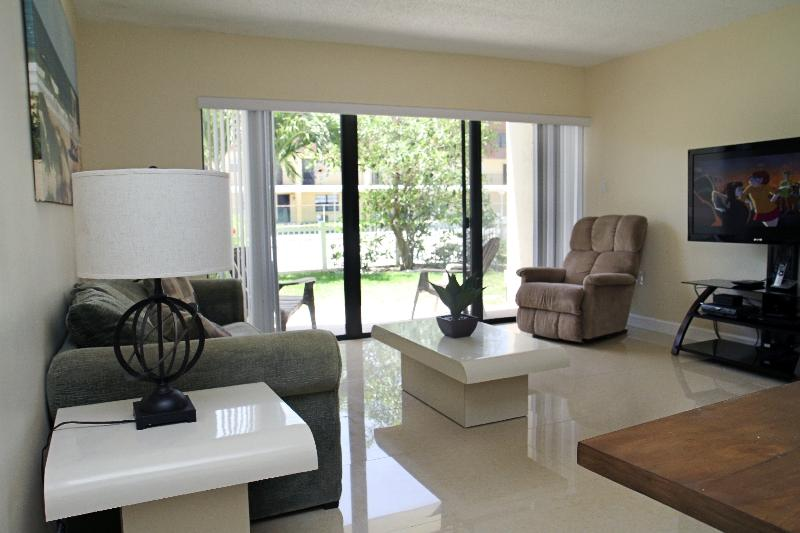 "Living Room with 52"" LCD TV and Sleeper Sofa - Bright & Spacious Ground Floor Corner Unit at Pier - Cocoa Beach - rentals"