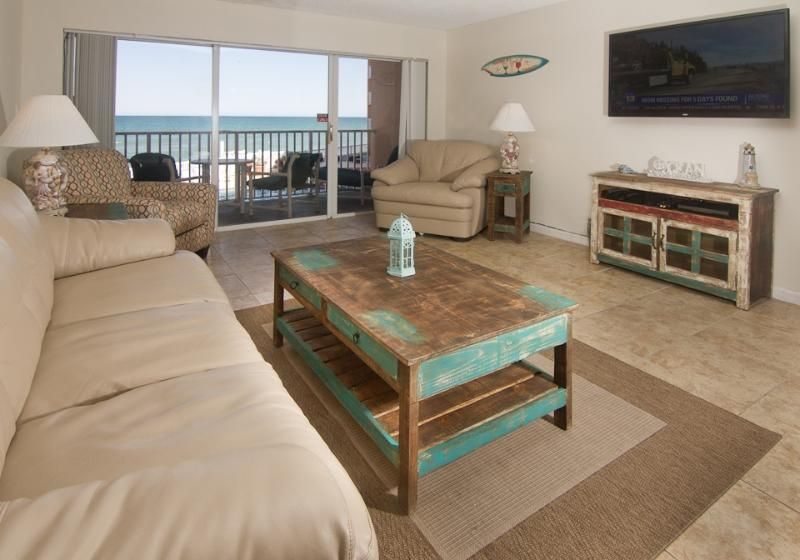 Living room with Oceanfront view, HD flat screen TV and all new furniture - Direct Oceanfront - Fully Renovated - VIEWS - Satellite Beach - rentals