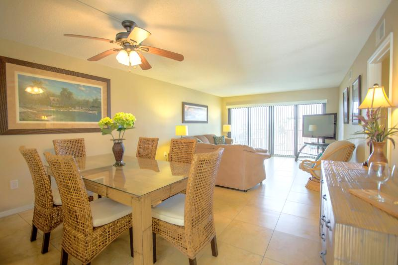 """Bright & new open-concept dining/living room with 50"""" flatscreen TV - Ocean View & Right on Beach! New Reno! - Cocoa Beach - rentals"""