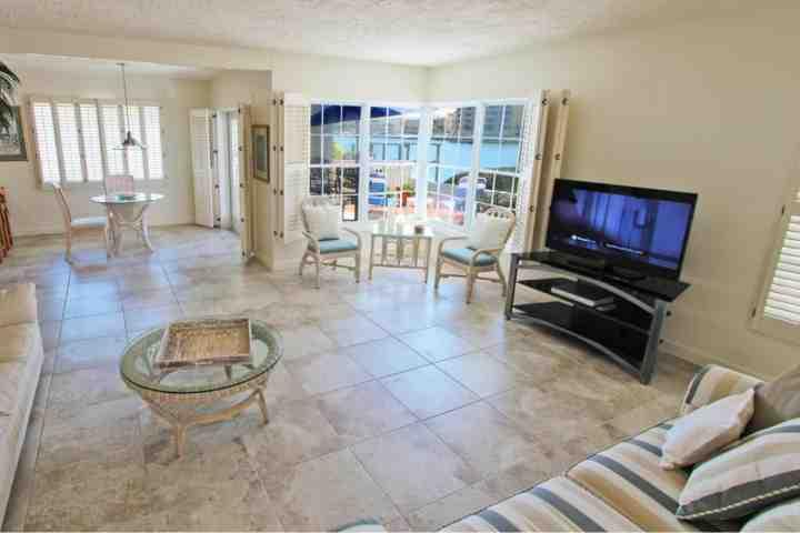 Spacious Living Room Area with Flat Screen Cable TV/Private Patio Overlooking The Intercoastal Waters of Clearwater - Key West Condo at The Beachouse - Clearwater - rentals