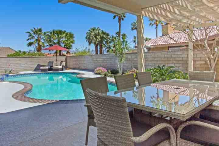 Enjoy poolside dining! - Nothin' but Good Times..Newly Remodeled Modern & Contemporary, Heated Pool & Spa - South Palm Desert - Palm Springs - rentals