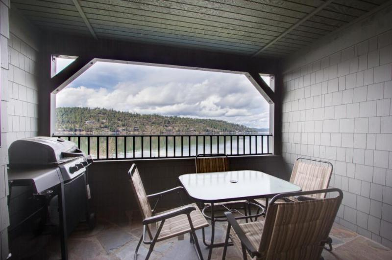 Shared pool, lakefront patio, serenity now at this condo! - Image 1 - Harrison - rentals