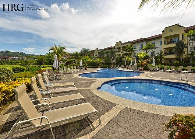 Pool area at Del Mar community with shaded palapas and BBQ´s - Your Dream Vacation Condo w/OceanView, close to amenities at Los Sueños! - Herradura - rentals