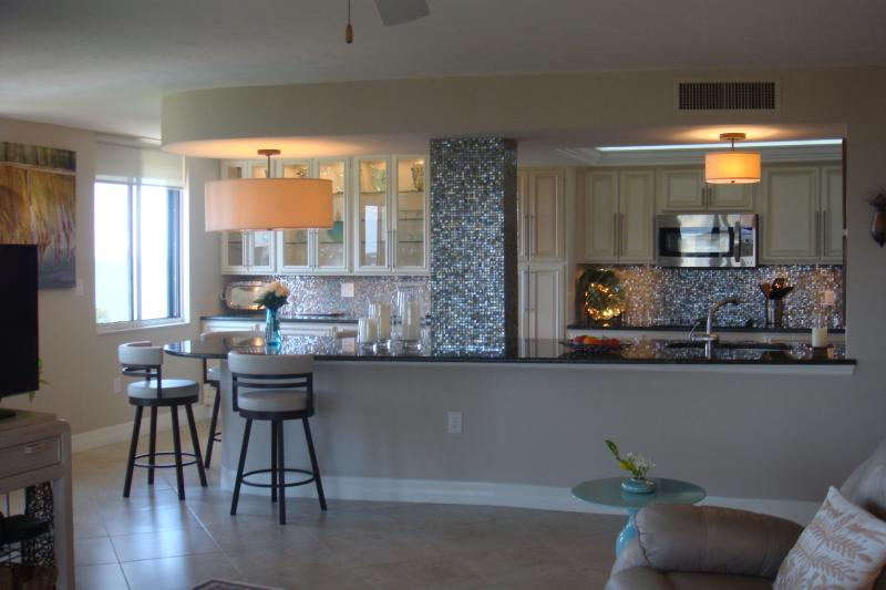 Dining surround sits four in an intimate space with a view - Gulf Views at Vanderbilt Surf Colony II--Short Walk to Beach - Naples - rentals