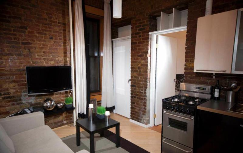 Exposed Brick Detailing - Comfortable 2 Bedroom, 1 Bathroom Apartment in SoHo - Image 1 - New York City - rentals
