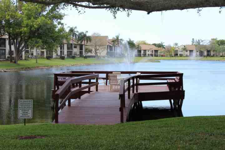 Peaceful views of the property and the lake from the sitting area - Cozy Crystal Lakes Condo - Fort Myers - rentals