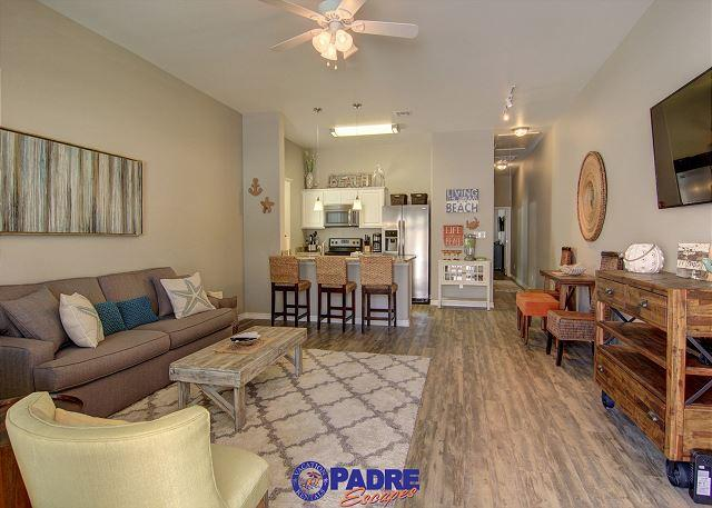 View of kitchen, dining and living area as you enter the unit - Beautiful New end unit on the pool and just steps off the Beach! - Corpus Christi - rentals