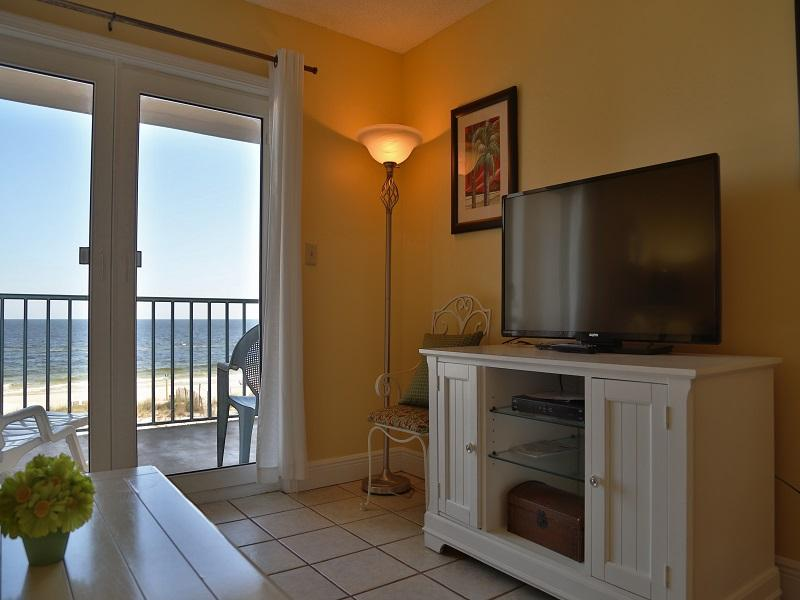 Living room TV with access to private balcony! - Surfside Shores 1306 - Gulf Front - Gulf Shores - rentals