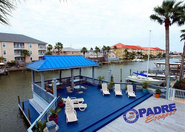 View of deck from patio - Waterfront Condo that overlooks the pool & close to Schlitterbahn - Corpus Christi - rentals