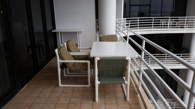 Balcony dining table to watch the  Gulf waves roll in or the walkers on the beach while  dining.  - Comfortable, Convenient, Economical & on the Beach - South Padre Island - rentals