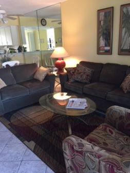 Living Room - Walk to the Beach and Local Attractions  from this cozy Island Condo ! - Marco Island - rentals