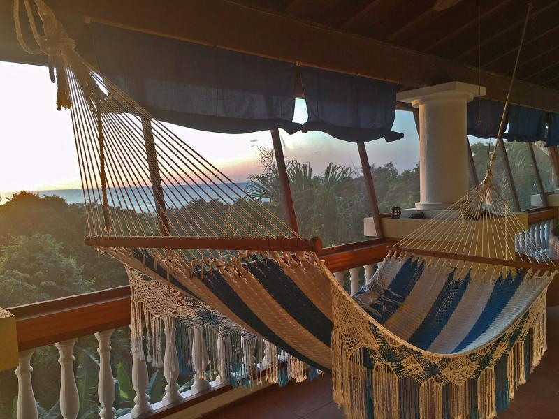 SeaView apartment, screened in living room deck, double hammock to relax and enjoy the sunset! - SeaView Apartment at Villa Delfin - West Bay - rentals