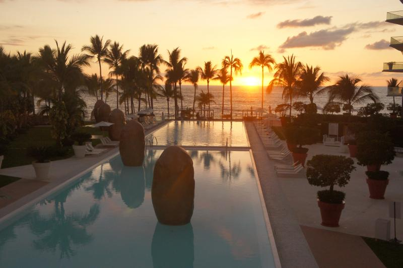 sunset from the balcony - Icon Vallarta: Stylish 2 Bedroom Beachfront Corner - Quimixto - rentals