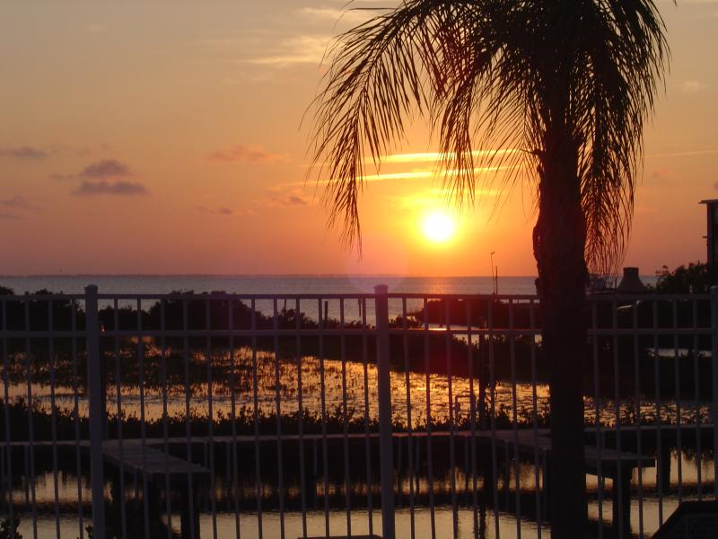 Bay sunset from the pool deck - Bayside luxury condo with boat dock - Port Isabel - rentals