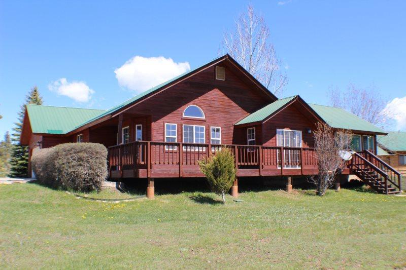 This 3 bedroom vacation home in Pagosa Springs offers a central location to many activities and beautiful views. - Image 1 - Pagosa Springs - rentals