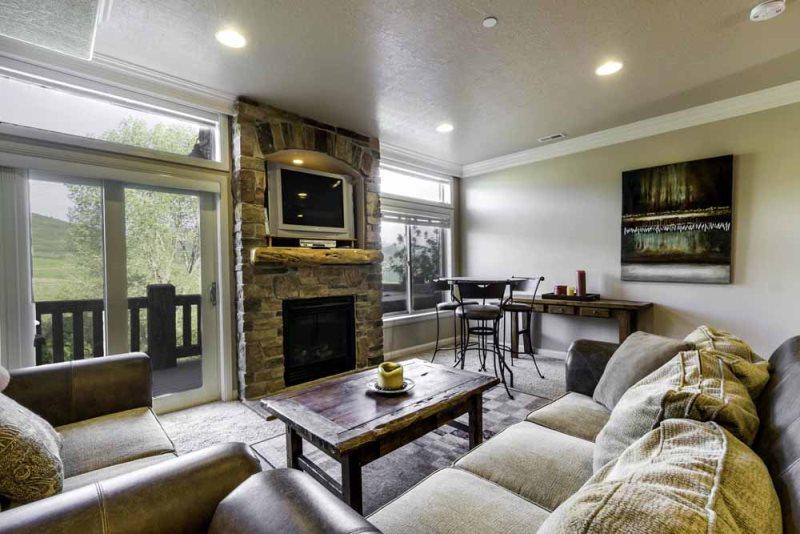 living area with gas fireplace / tv - Lakeside Unit 46 | 2 Bed - Huntsville - rentals