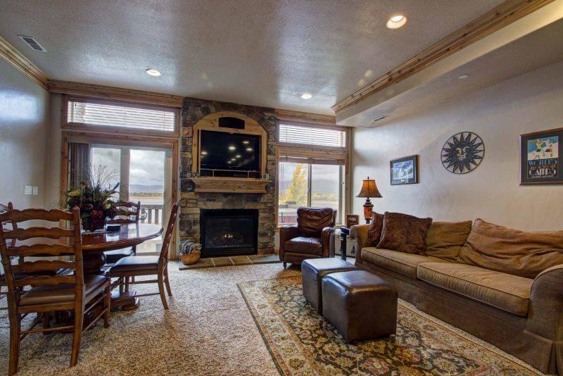 Living area/gas fireplace/tv - Lakeside Unit 57 | 2 Bed - Huntsville - rentals