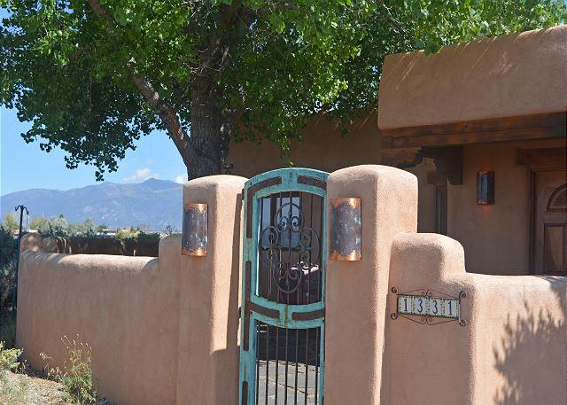Turquoise gate entering adobe wall enclosed front courtyard  - House of the Turquoise Gate 360 Degree Views with Enclosed Yard - El Prado - rentals
