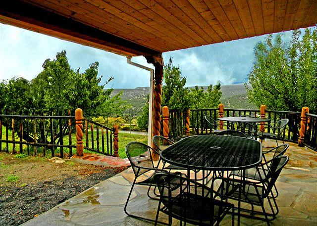 Side yard with large portal for outdoor grilling and dining offers mountain view - Campo Verde- 2 Acres with Fruit Orchard and Private Stream- Hot Tub - Arroyo Seco - rentals