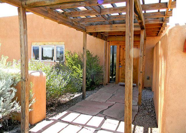 "Shaded front entry also on the way to a mountain view adobe wall enclosed private yard  - John Shaw's Guest House ""green architecture"" known as ""Earthships"" - El Prado - rentals"