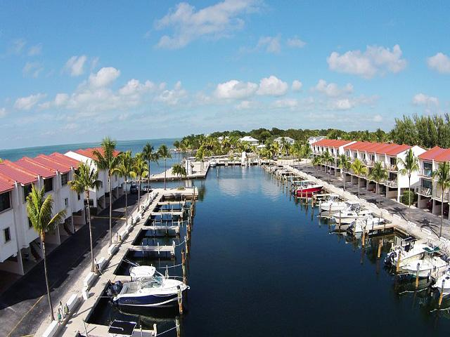 protected marina with slips available for up to 36 ft boat - Elegant Bayfront Townhouse with boat slip - Islamorada - rentals